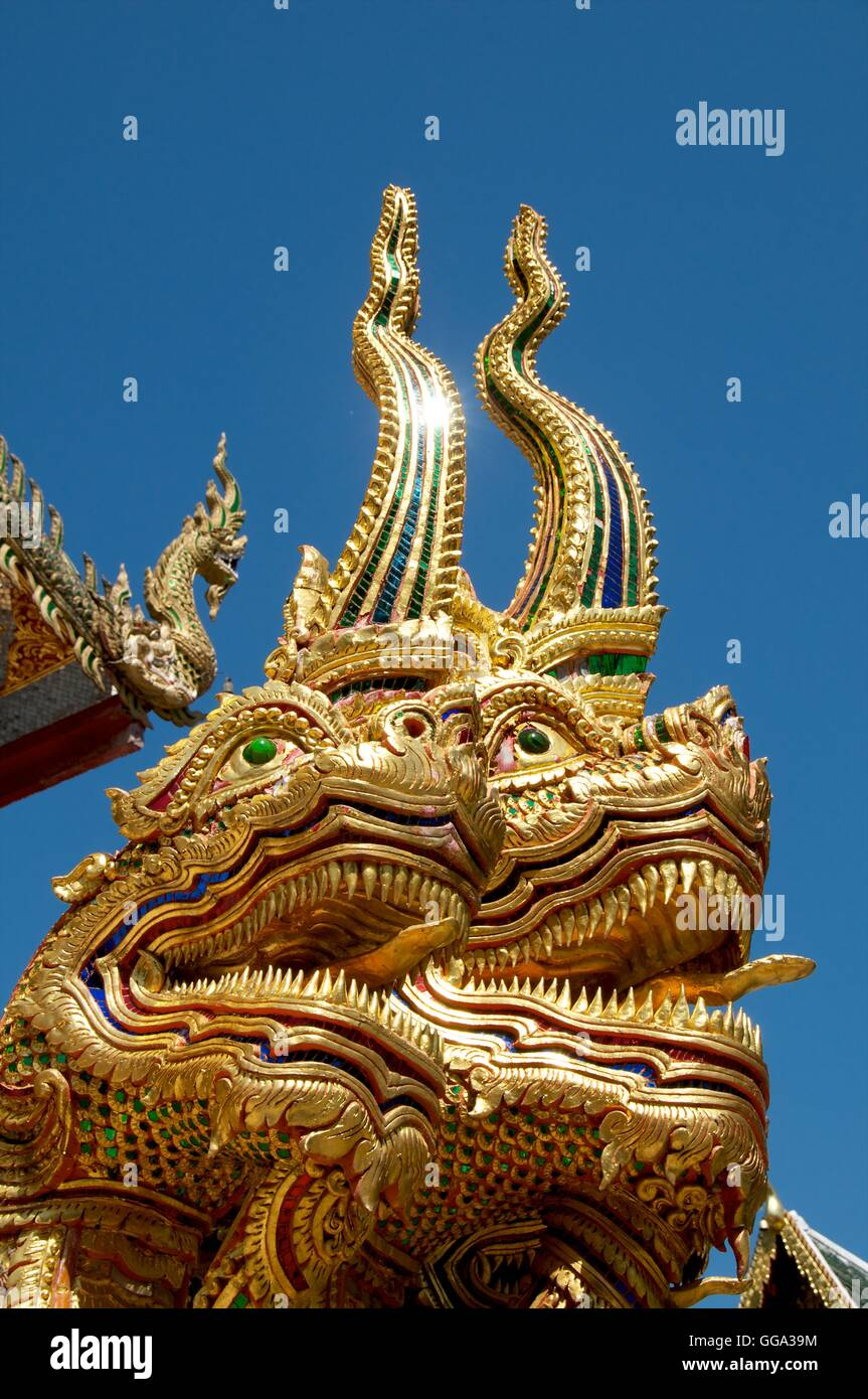 Nagas (mythical creatures) protecting the entrance to Wat Mahathat, Lamphun, Thailand. - Stock Image