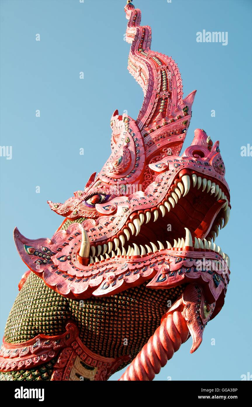Head of naga (mythical creature) guarding entrance to Wat Ban Den, near Chiang Mai, Thailand - Stock Image