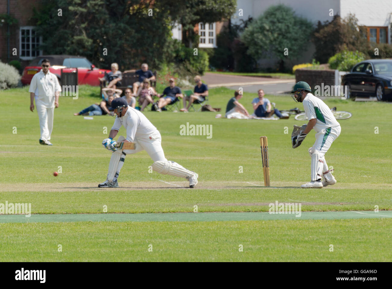 Village cricket being played in Hartley Wintney, Hampshire, UK. Stock Photo