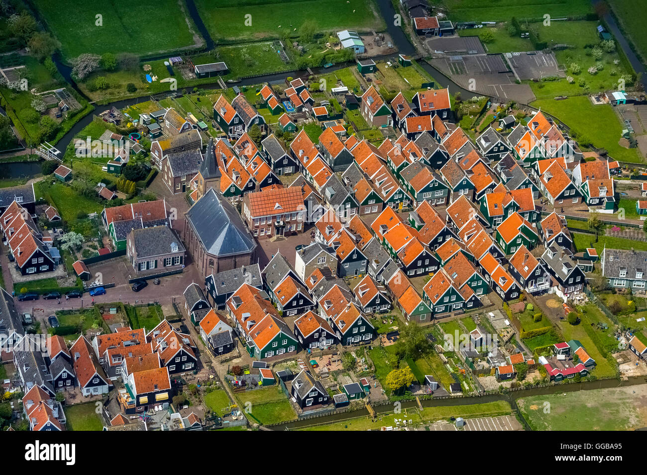 Aerial view, island of Marken, with small fishing houses and the town church, red roofs brands, small dutch houses,pointed - Stock Image
