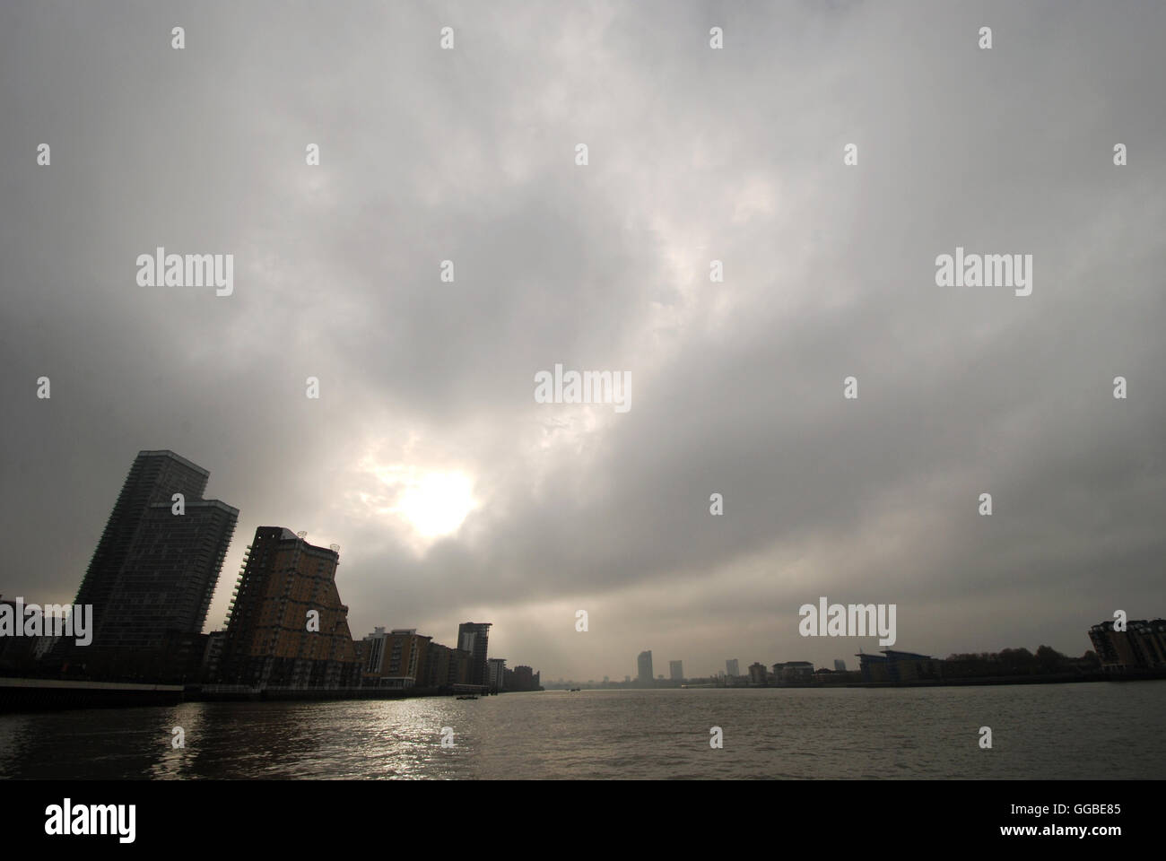 Taken from the river bus dock at Canary Wharf looking along the river Thames downstream Stock Photo