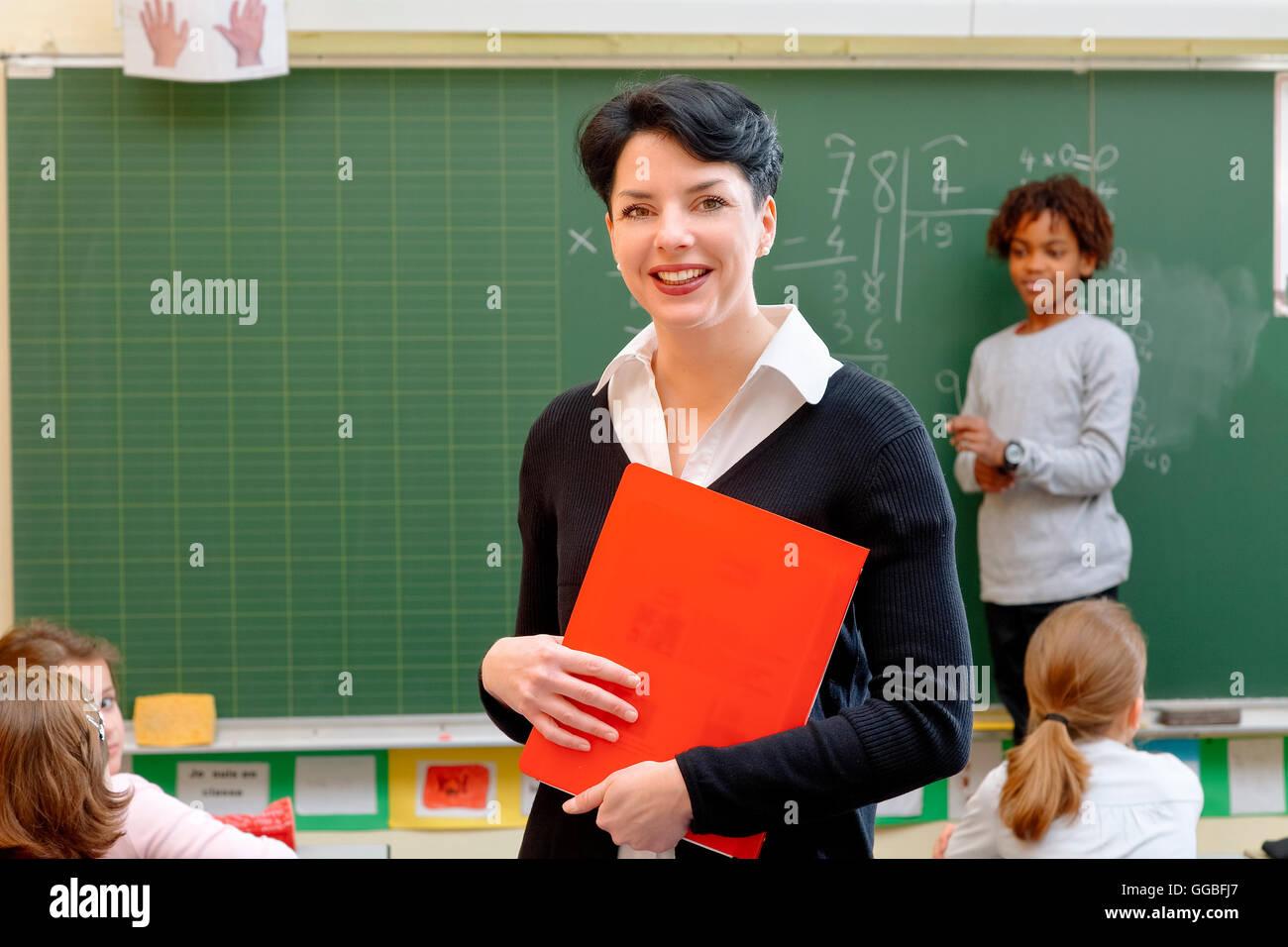 Portrait of a teacher in classroom - Stock Image