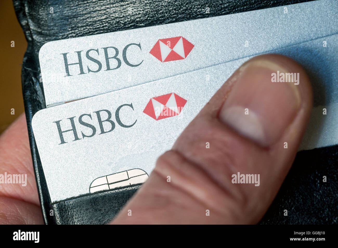 Signage and cheque books with logo from HSBC Bank. - Stock Image