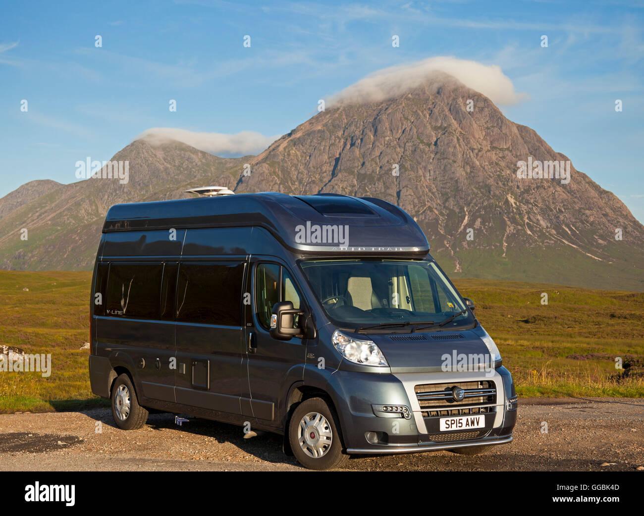 Camper van in foreground with Buchaille Etive Mor in background Lochaber Scotland UK - Stock Image