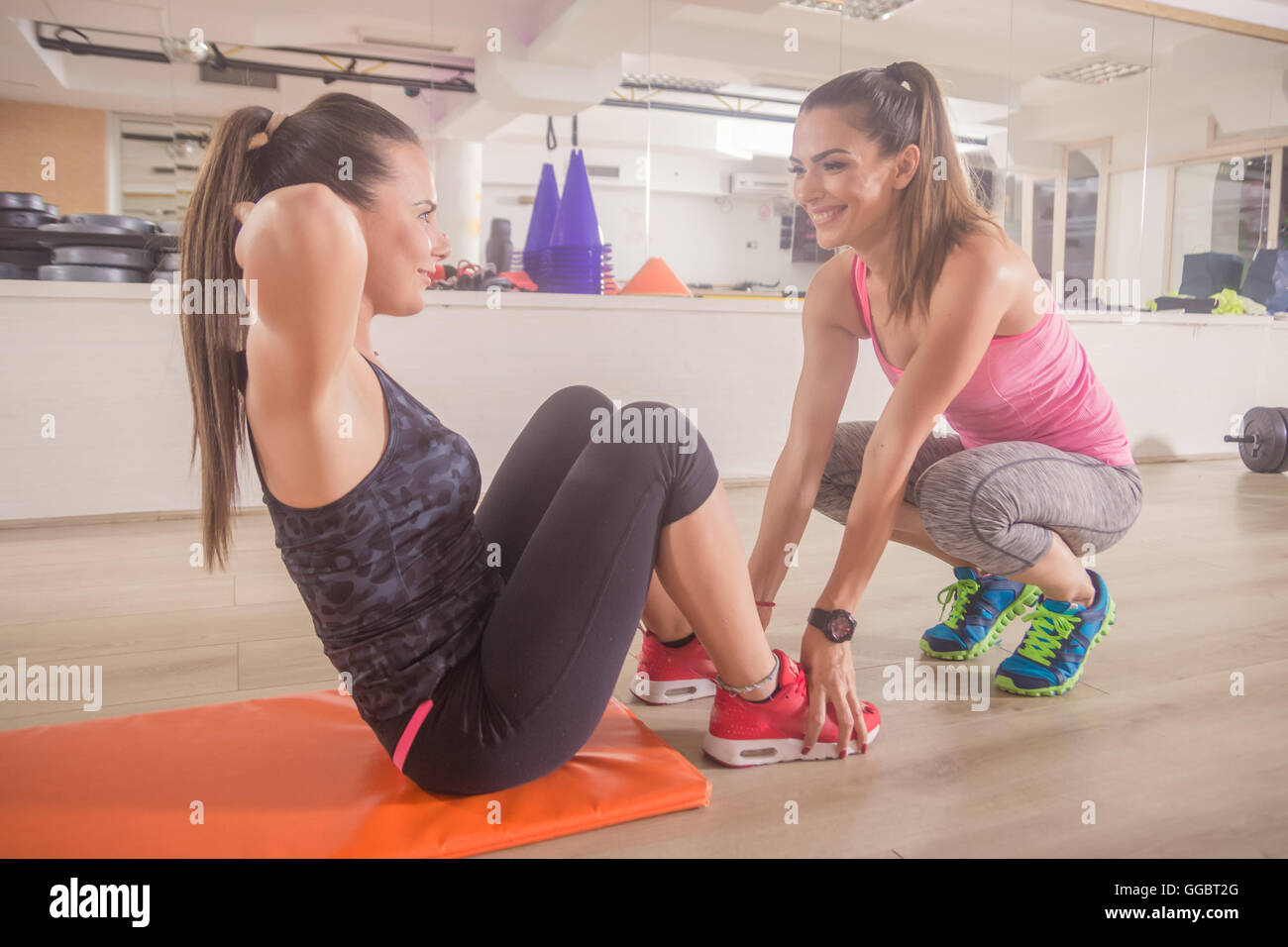 Two Women Training Instructor Abs Workout Gym