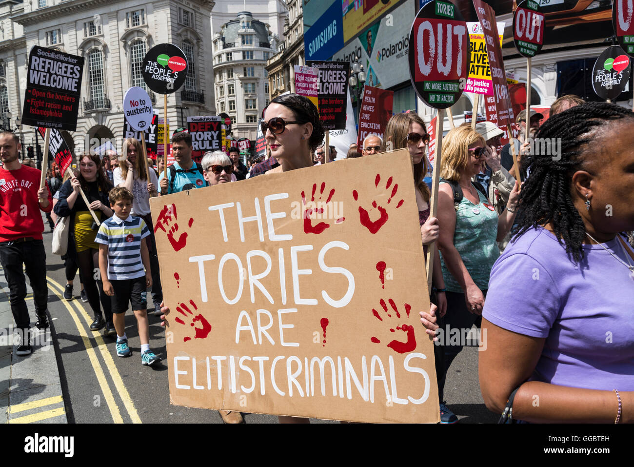 Tories are elitist criminals, No More Austerity - No To Racism - Tories Must Go demonstration, Saturday July 16th - Stock Image