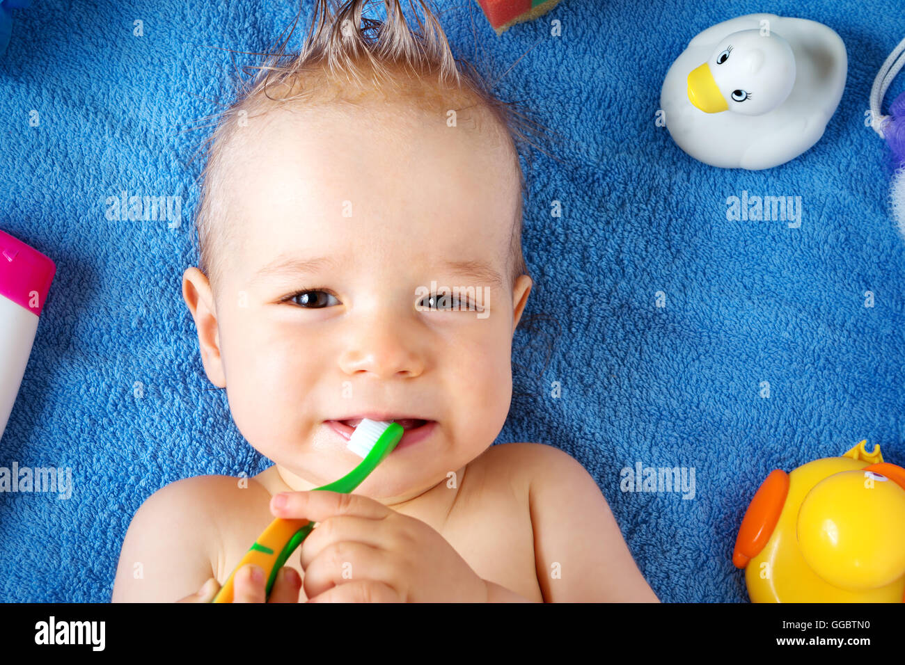 Baby lying on towel with washing tools Stock Photo: 113357580 - Alamy