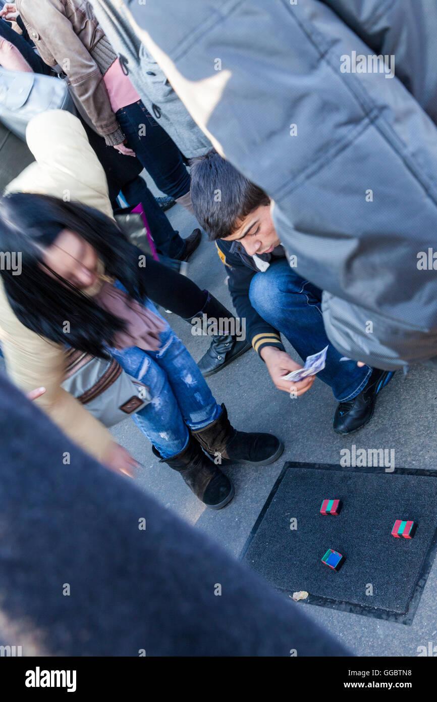 Illegal gambling on the street, London, England, UK - Stock Image