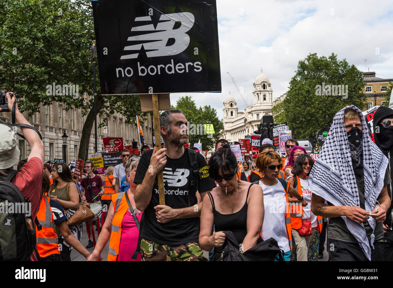 No borders, No More Austerity - No To Racism - Tories Must Go, demonstration organised by Peoples Assembly, Saturday - Stock Image