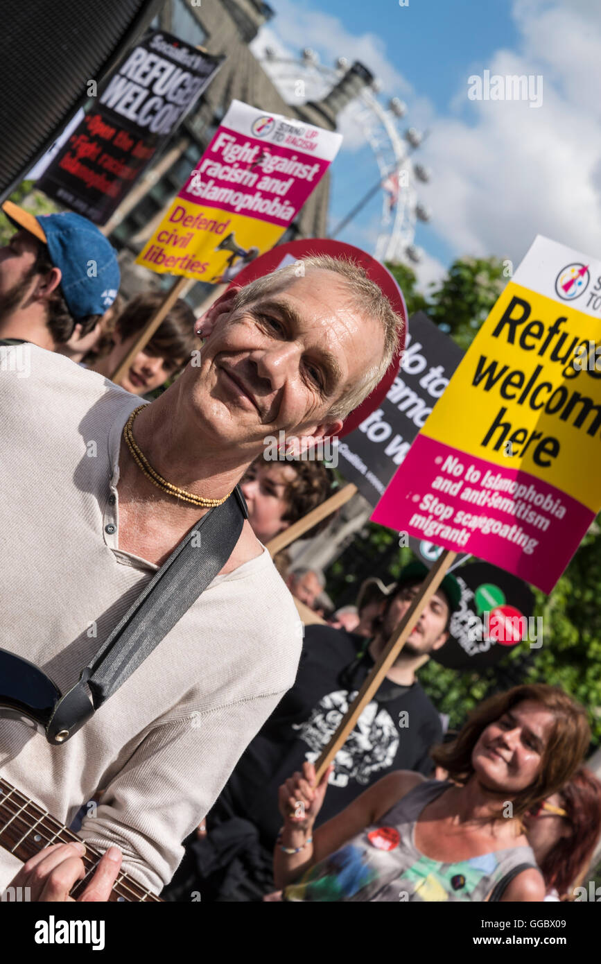 Hare Krishna playing music, No More Austerity - No To Racism - Tories Must Go demonstration, July 16th 2016, London, - Stock Image