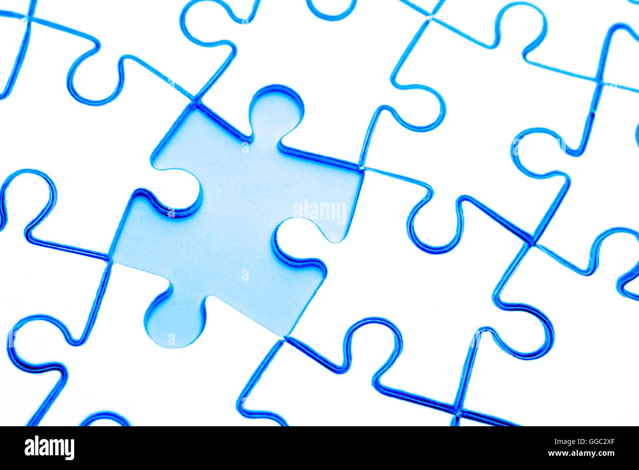 Piece missing from jigsaw puzzle Stock Photo