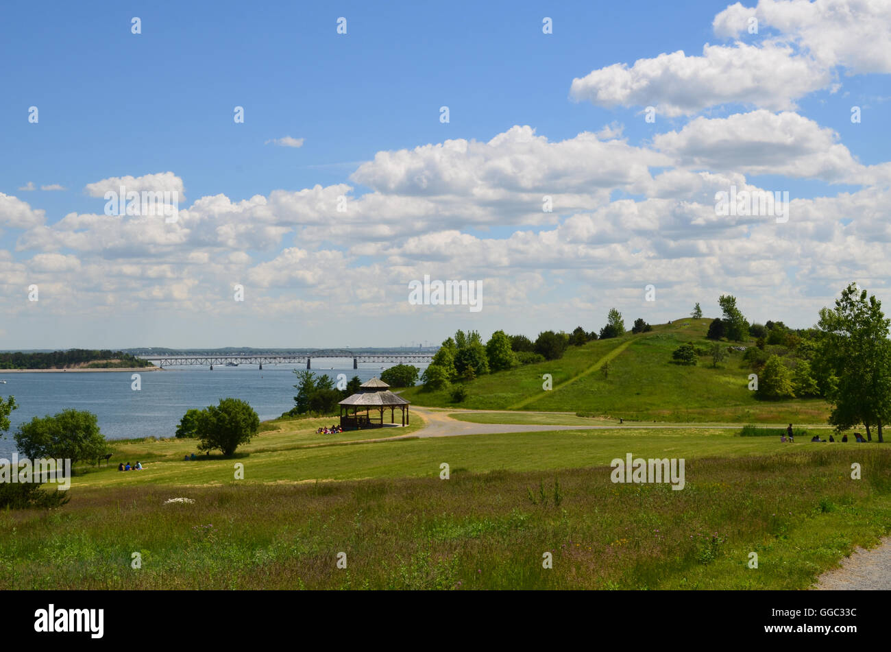 Hiking trails on Spectacle Island on a beautiful day with fluffy white clouds in the sky. - Stock Image