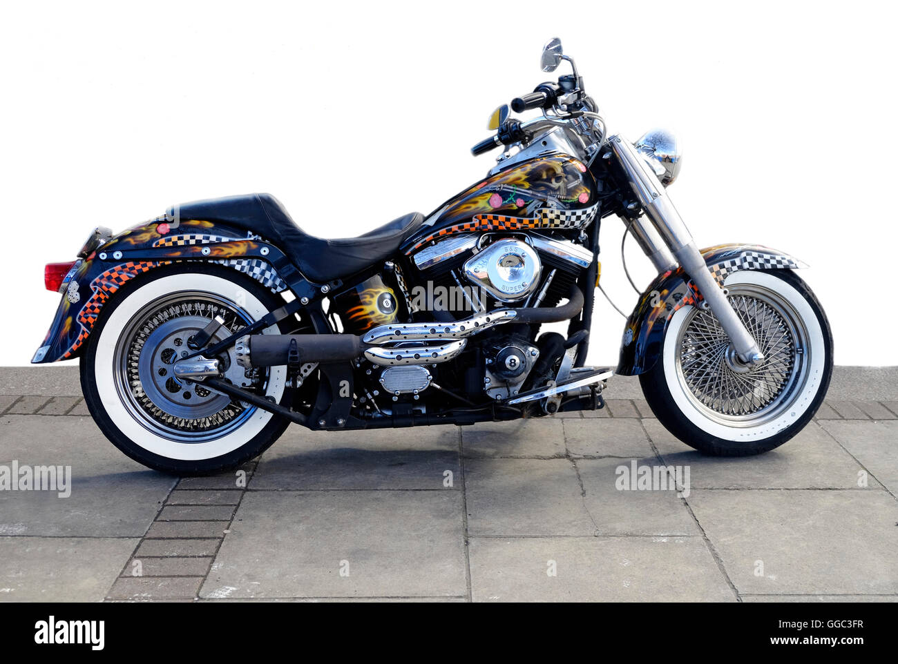 A highly customized Harley Davidson Motorcycle parked on a Dublin street, shown as a partial cut-out - Stock Image