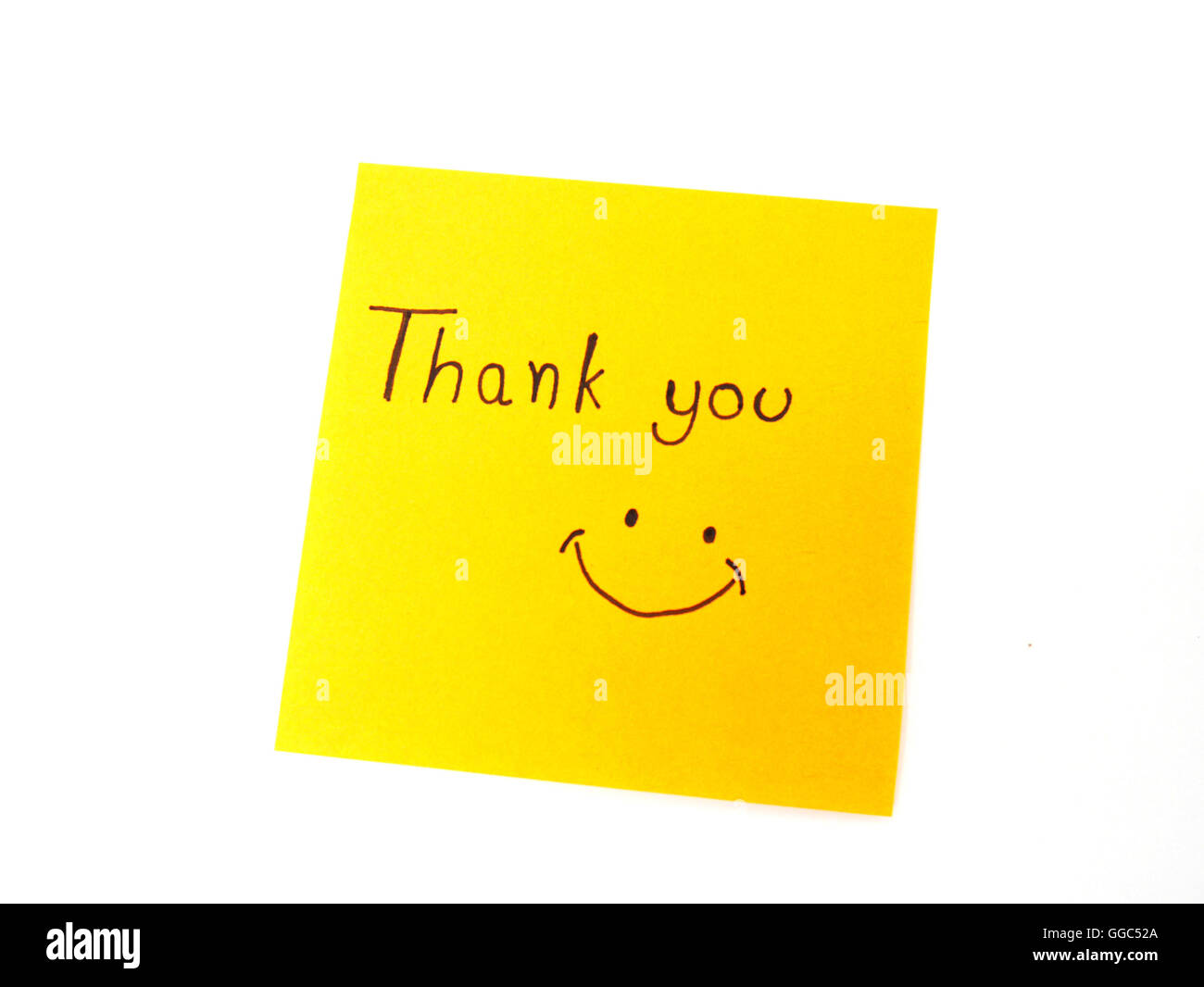 Writting 'Thank you' on post it note for someone - Stock Image