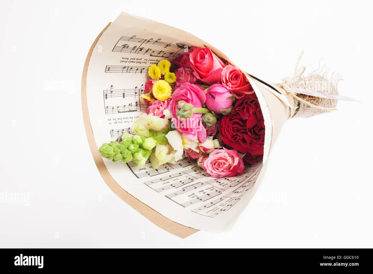 gift floral bouquets wrapped in brown and music paper Stock Photo ...