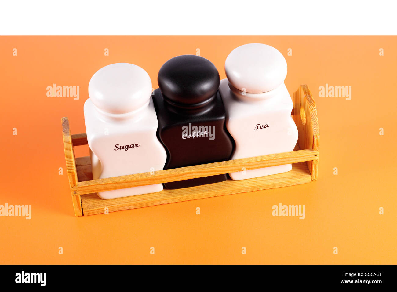 Capacities for condiment spices - Sugar, coffee, tea a set on a orange background. - Stock Image