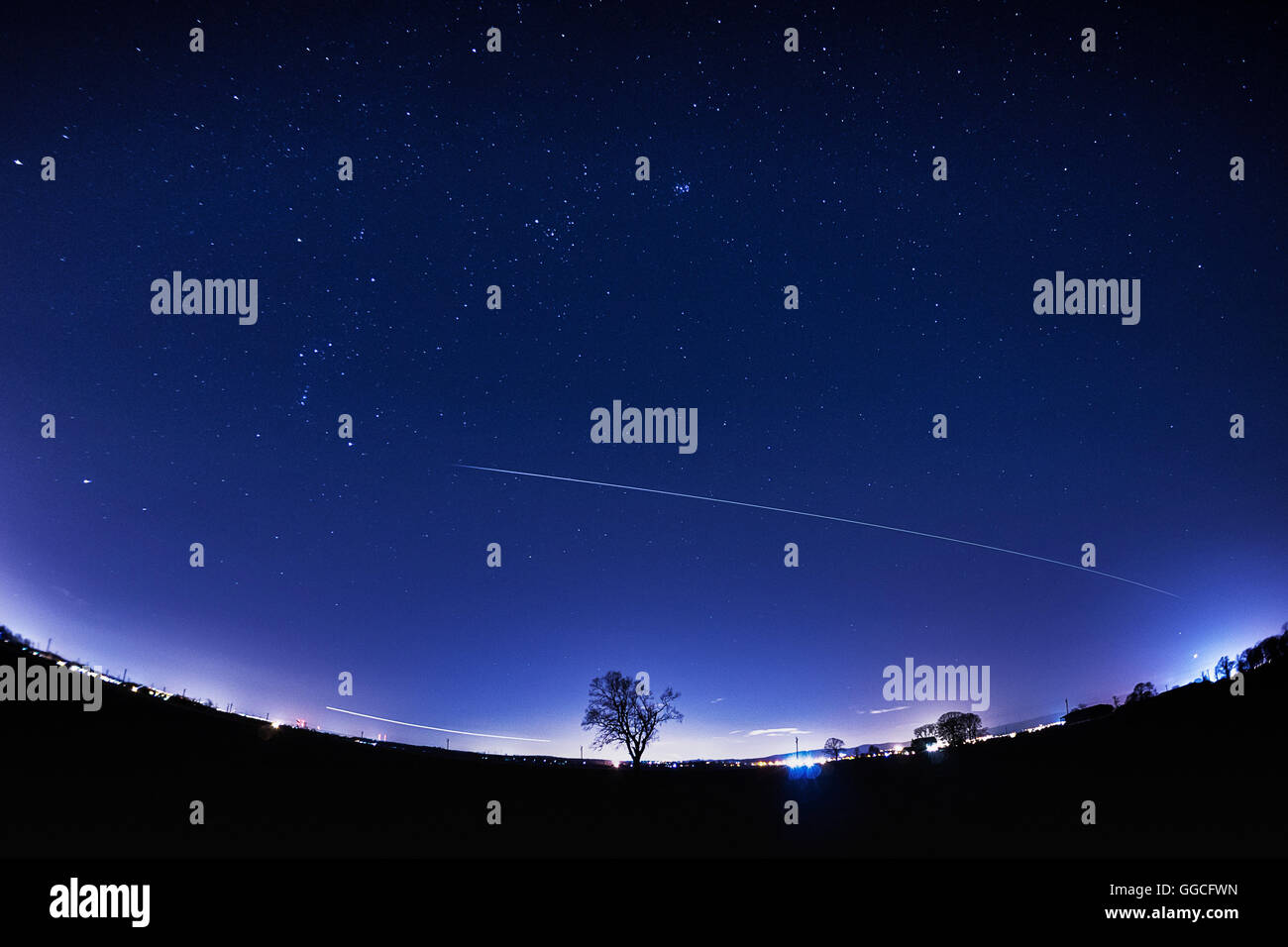 International Space Station (ISS) fly past in a clear starry sky - Stock Image