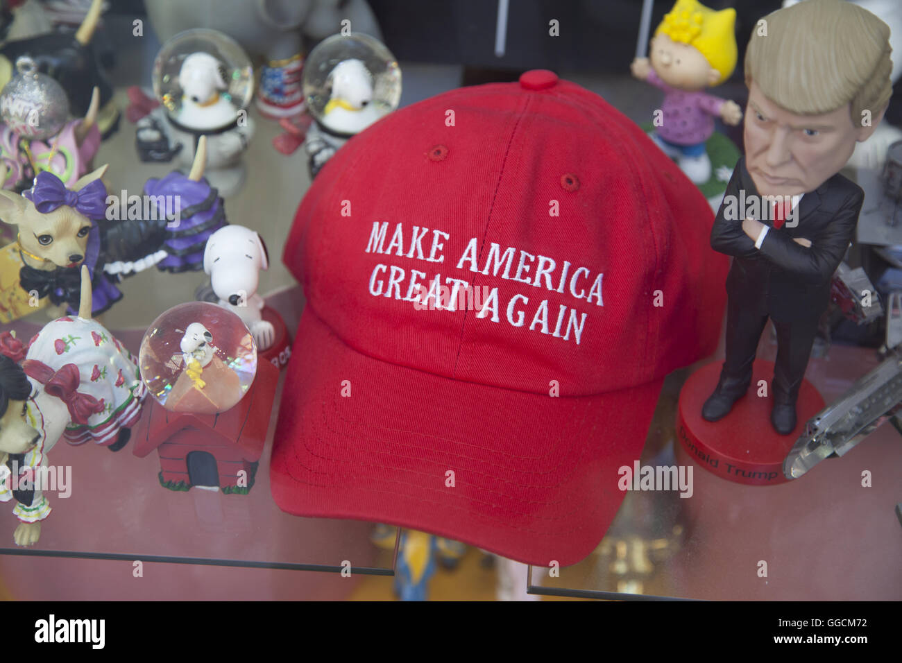 Caricature of Donald Trump with hisiconic red hat at a souvenir shope in New York City. - Stock Image