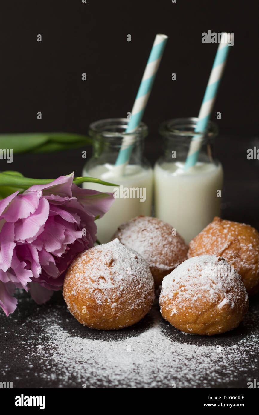 Jelly doughnuts and two bottles of milk - Stock Image