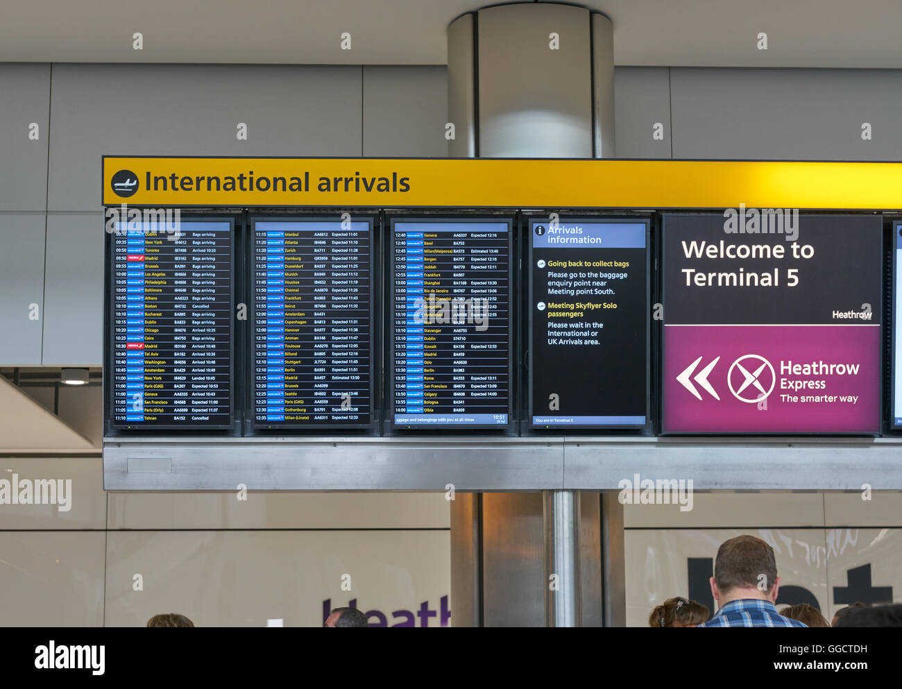 arrivals board at airport,  heathrow arrivals,  airplane arrivals terminal 5 - Stock Image