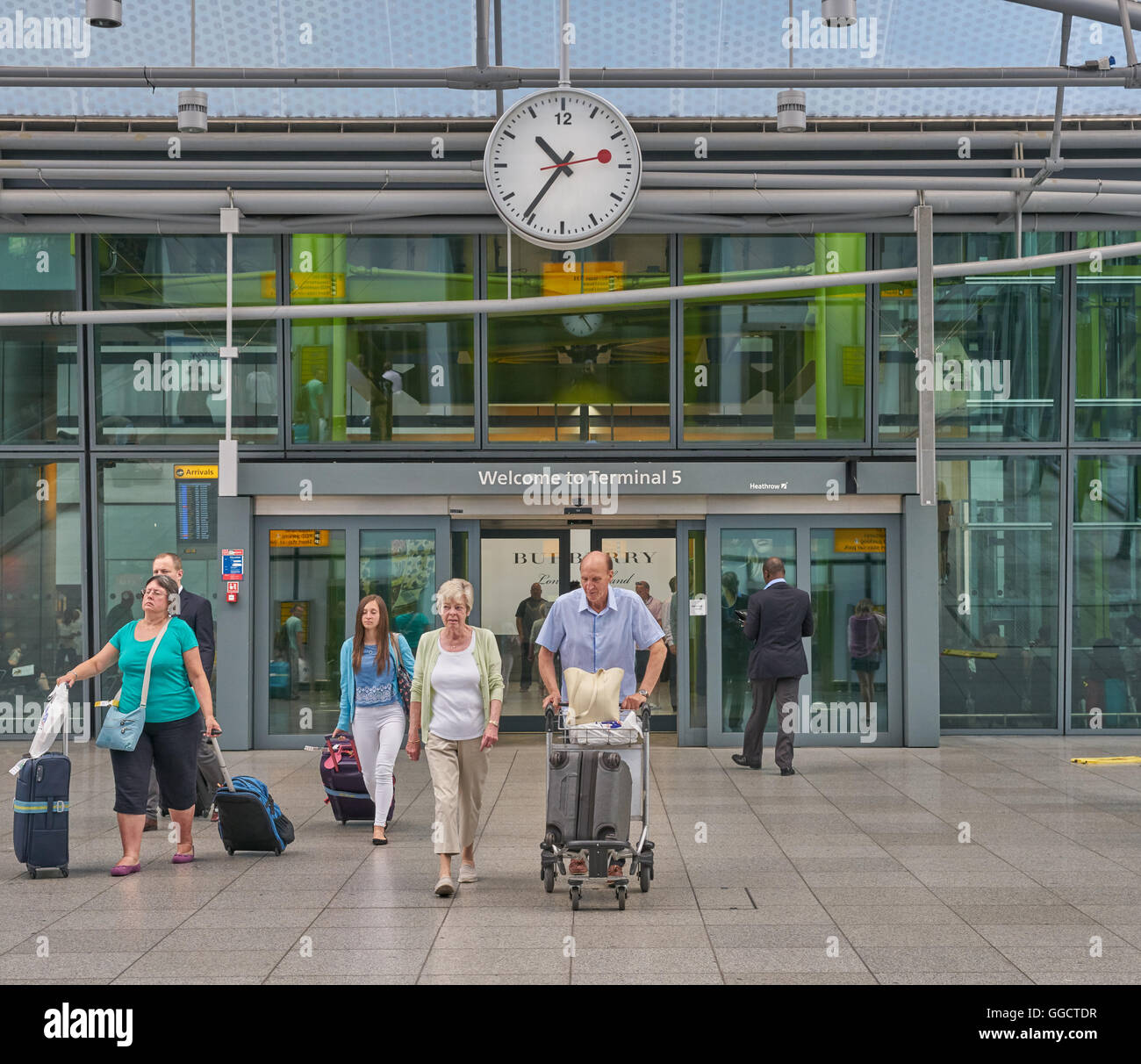 terminal 5 heathrow airport  passengers leaving terminal - Stock Image