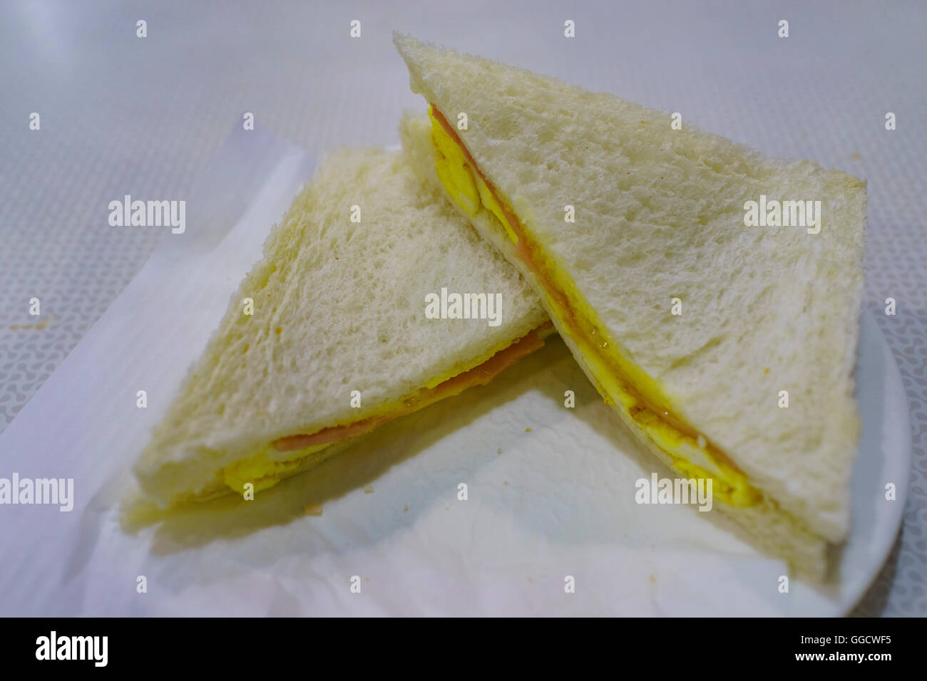 Ham and Egg Sandwich is one of the most popular and famous snacks in Macau. - Stock Image