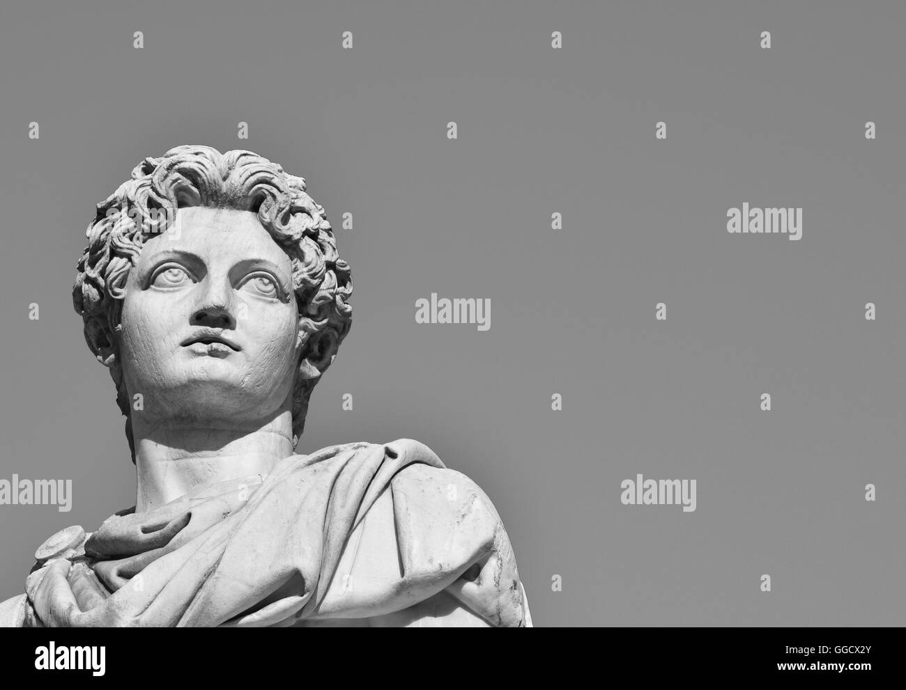 Ancient marble statue of Dioskouri at the top of monumental balustrade in Capitoline Hill, Rome (B/W) - Stock Image