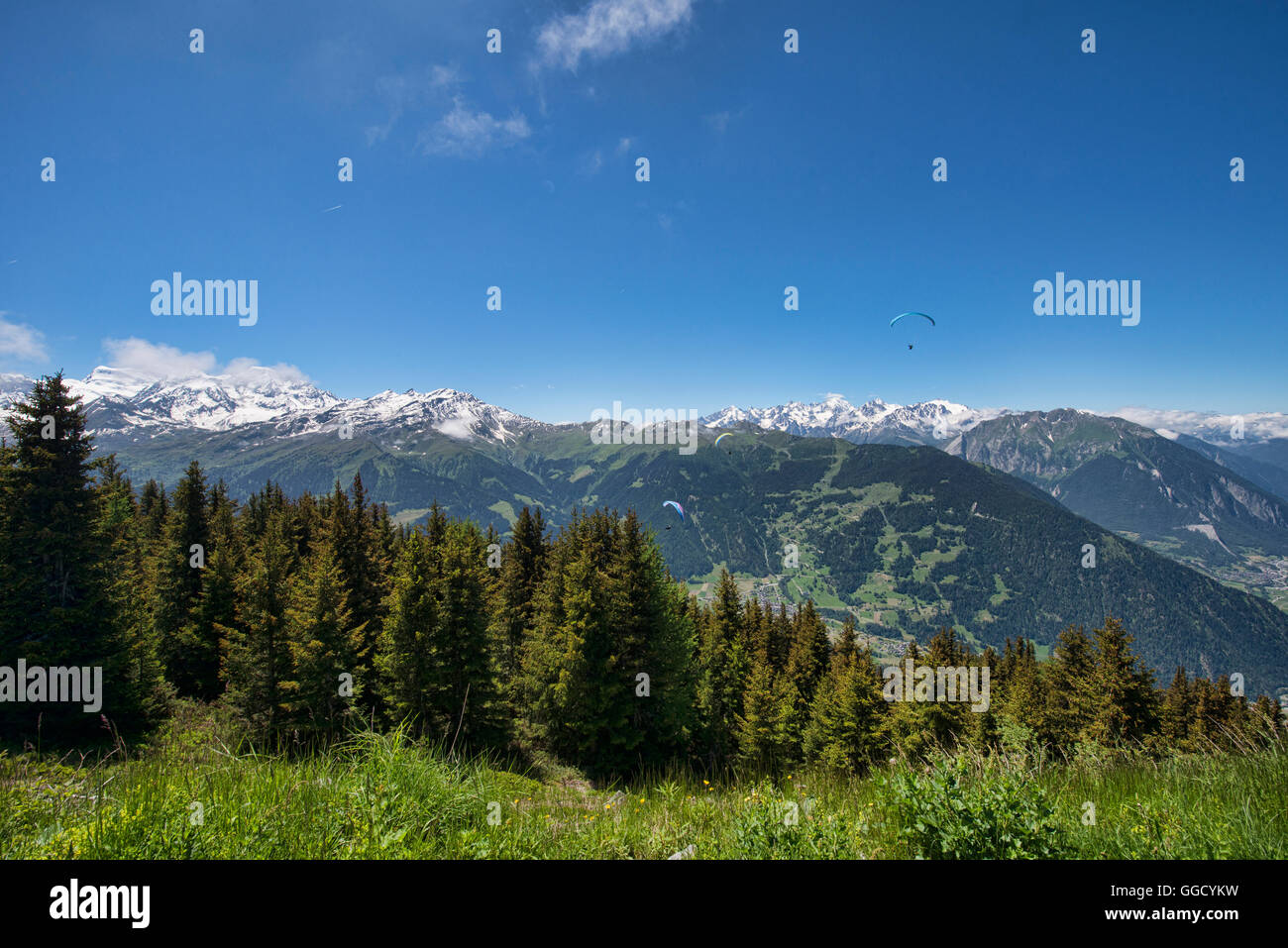 Parasailing over the Grand Combin and Val de Bagnes, Verbier, Switzerland - Stock Image
