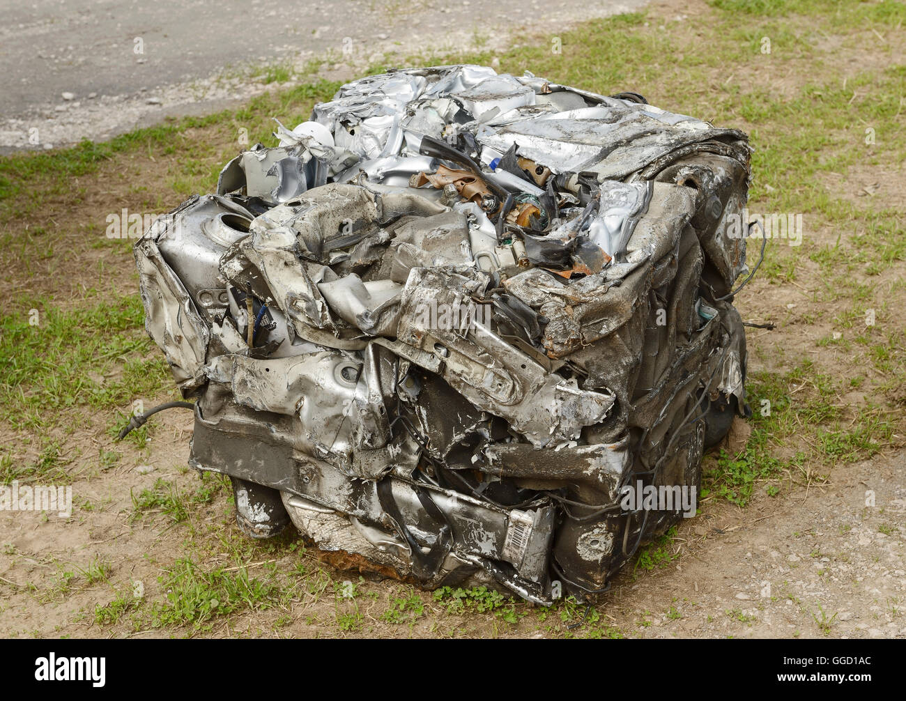 A square of metal formed from a car that has been put through a car crusher. - Stock Image