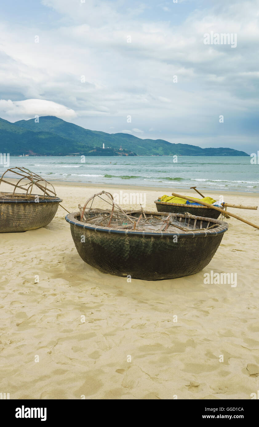 Bamboo waterproof round fishing boats on the China Beach in Danang in Vietnam. It is also called Non Nuoc Beach. - Stock Image