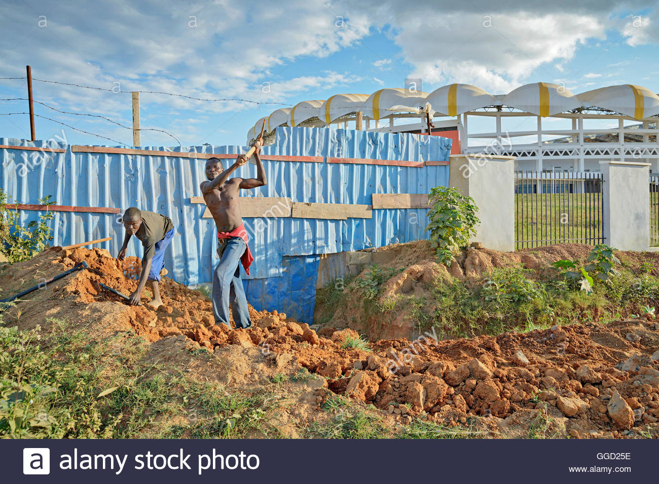geography / travel, Zambia, Lusaka, Workers near the new Chinese-funded football stadium in Lusaka, the capital - Stock Image