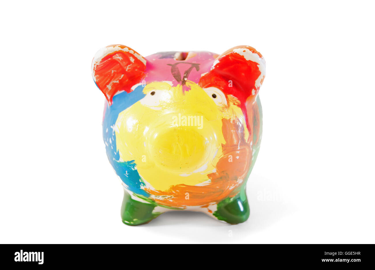 A multi colored piggy bank on a white background. - Stock Image