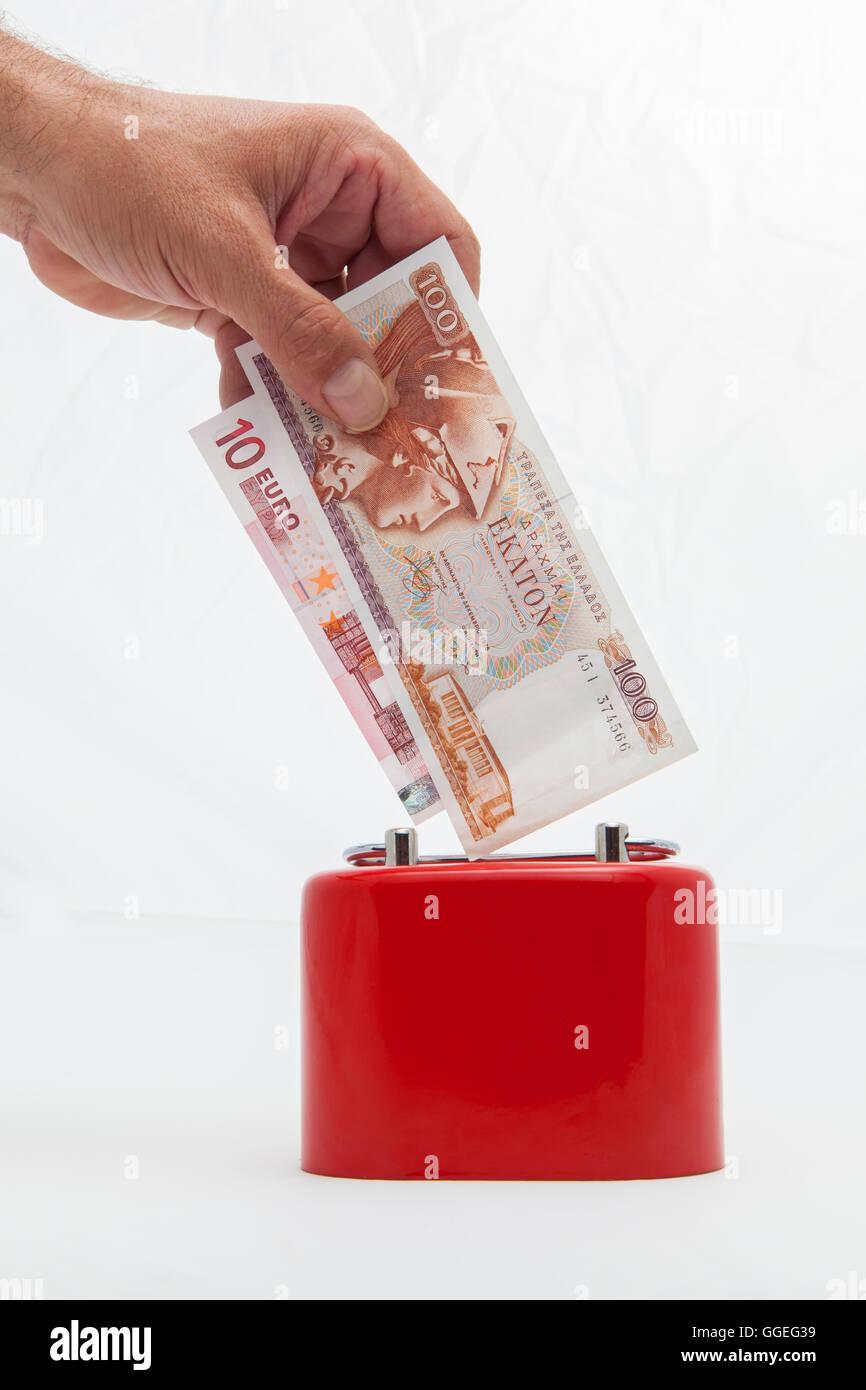 saving money drachmas or euro - Stock Image