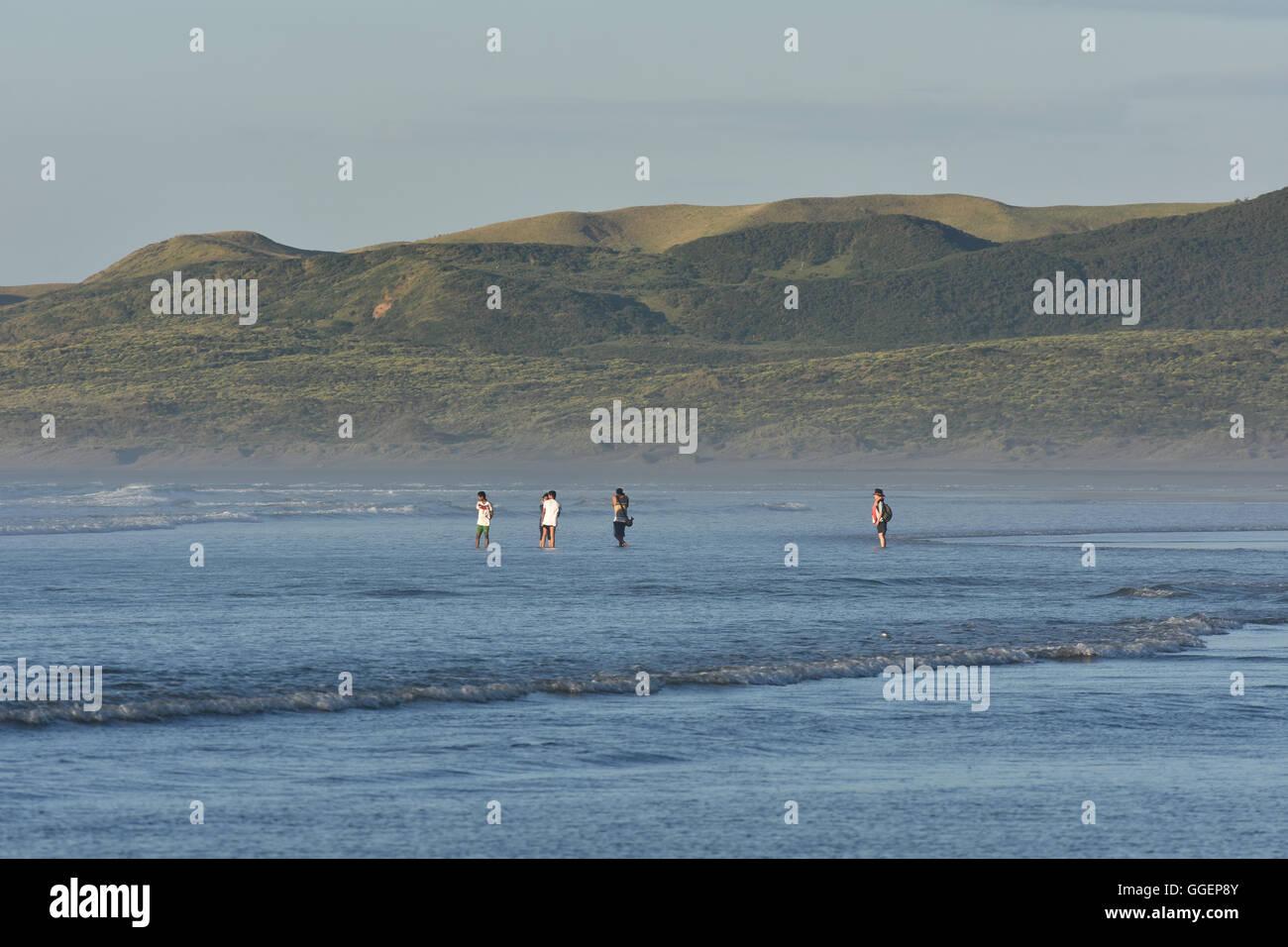 people NZ Raglan beach sea - Stock Image