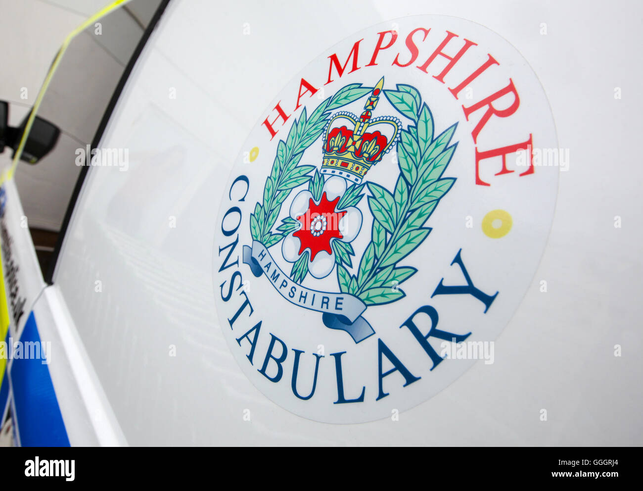 Hampshire Constabulary police logo on the side of a police van - Stock Image