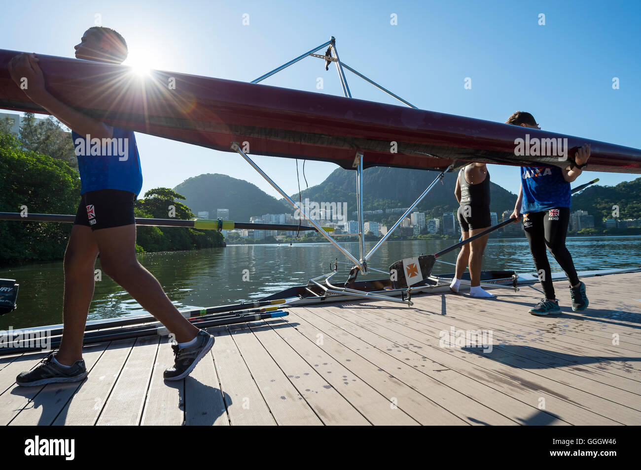 RIO DE JANEIRO - MARCH 22, 2016: After training, a female Brazilian rower carries her boat back to the clubhouse - Stock Image
