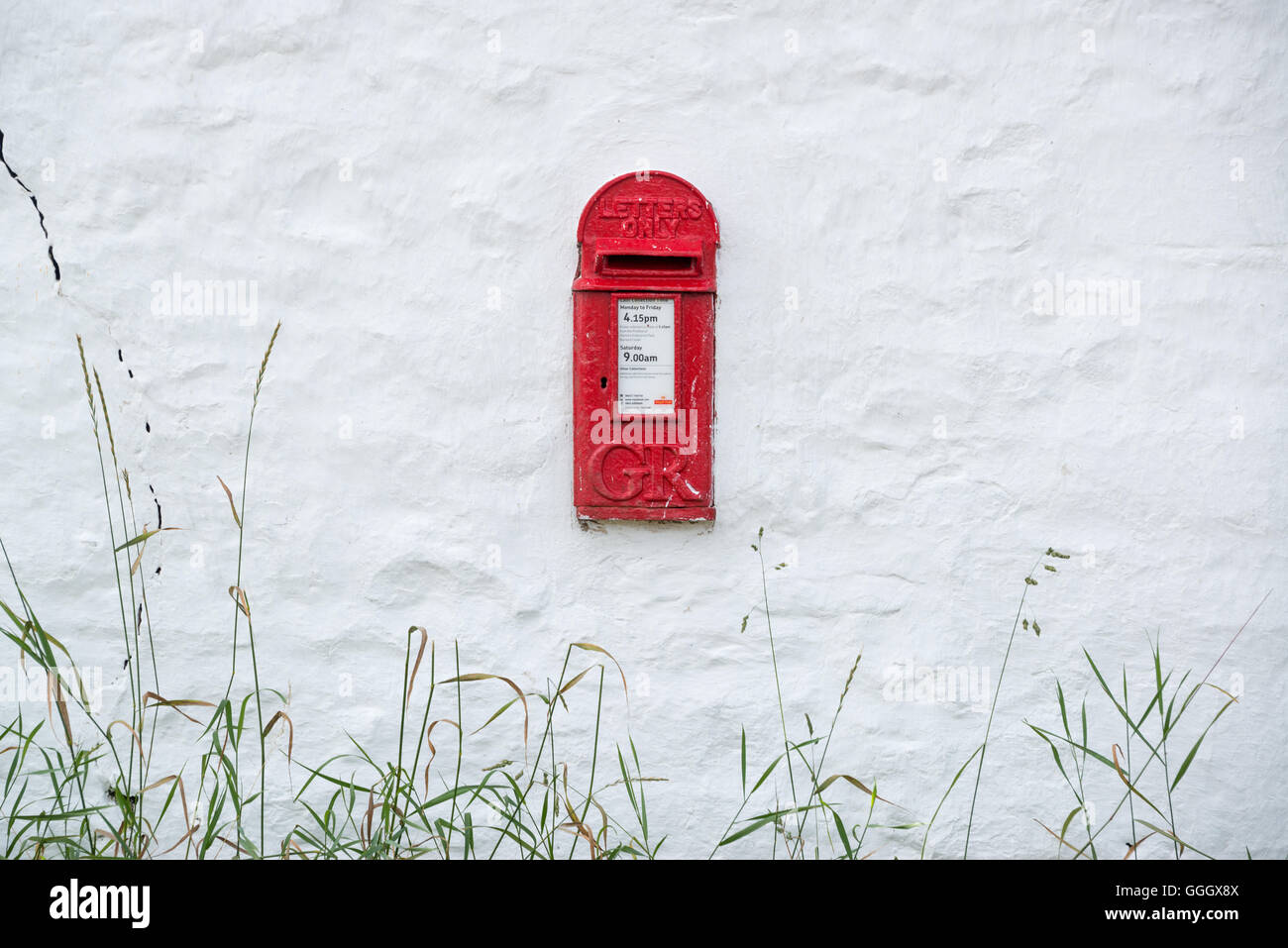 Postbox set in the side of a wall, Bowes, Teesdale - Stock Image