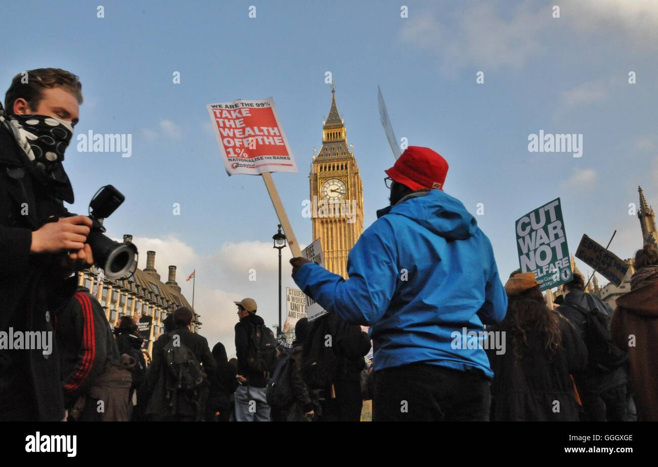 Protests by students against tuition fee cuts. - Stock Image