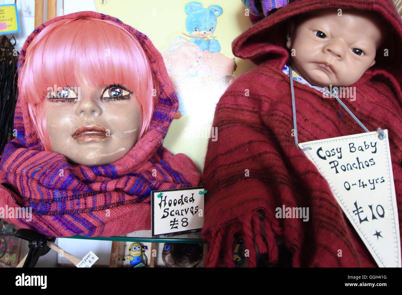 Scarves and ponchos for babies on sale display in The Vaults, an antiques and vintage items store in Sheffield Antique - Stock Image