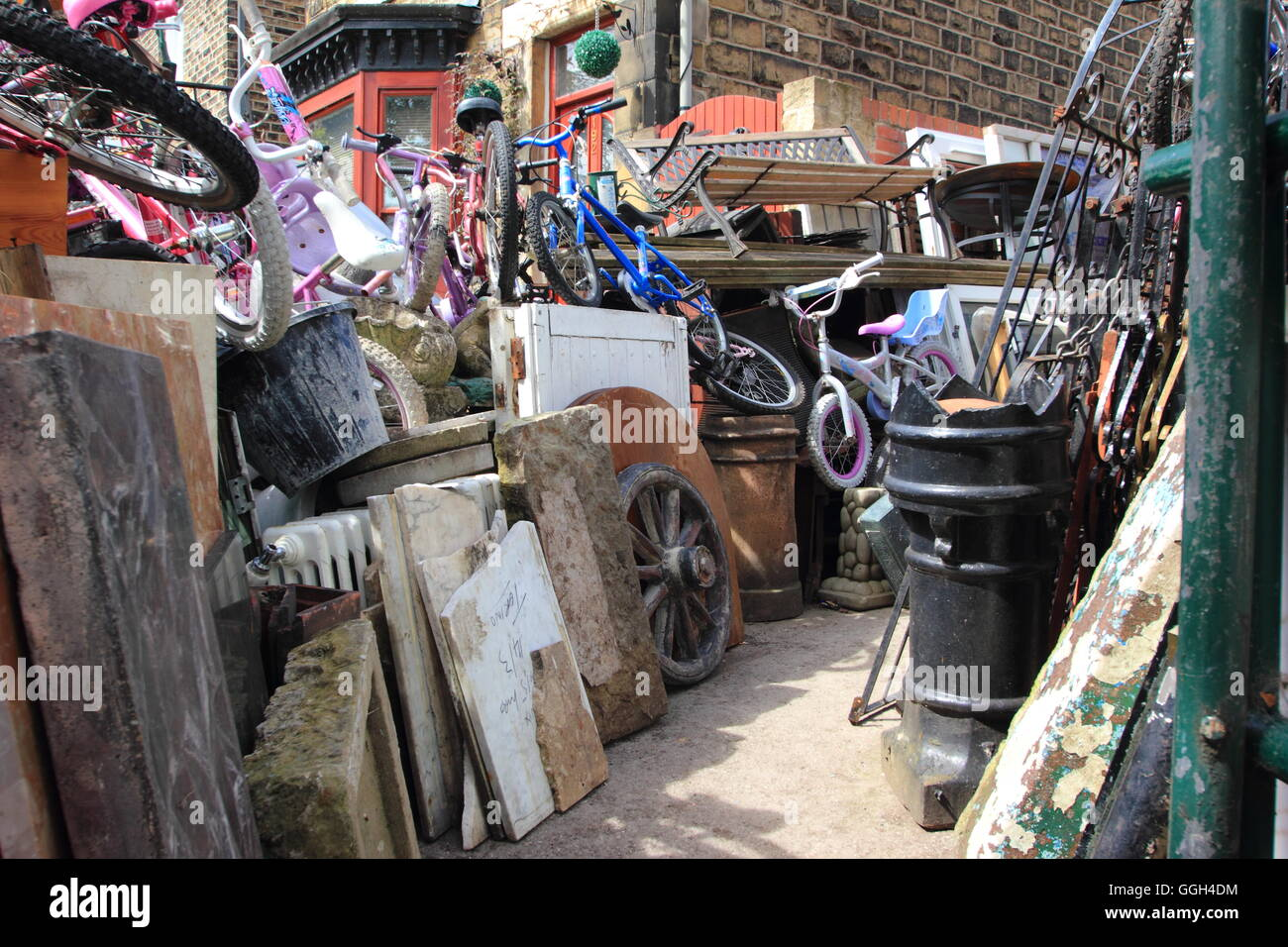 An eclectic mix of salvaged items for sale in the yard of T H Goode's store in the heart of Sheffield's - Stock Image