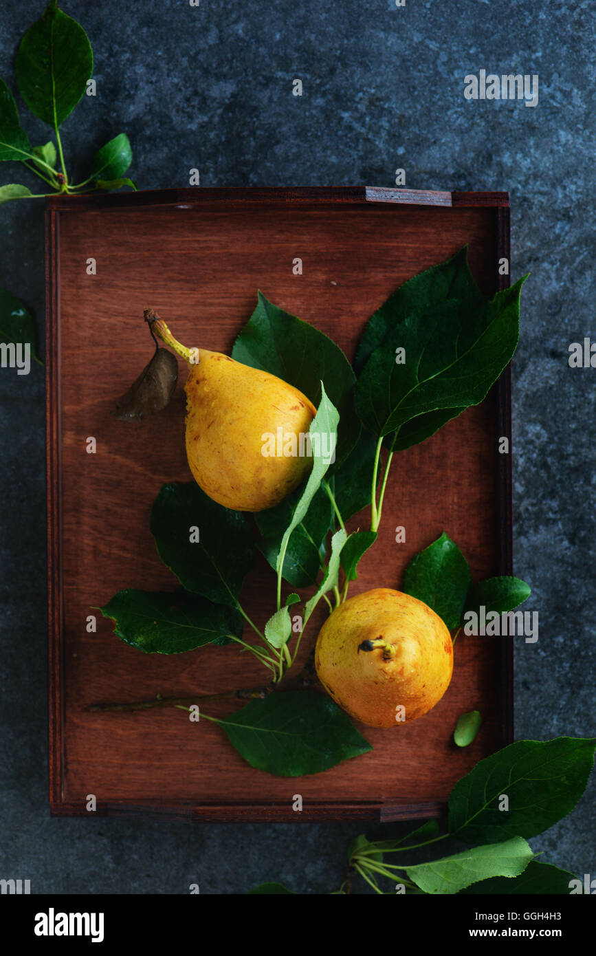 Wooden tray with pears - Stock Image