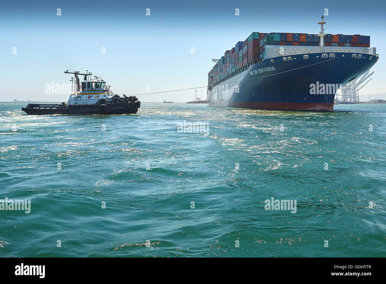 The Giant, CMA CGM Centaurus, Container Ship Is Manoeuvred Into Pier J At The Long Beach Container Terminal, California, - Stock Image