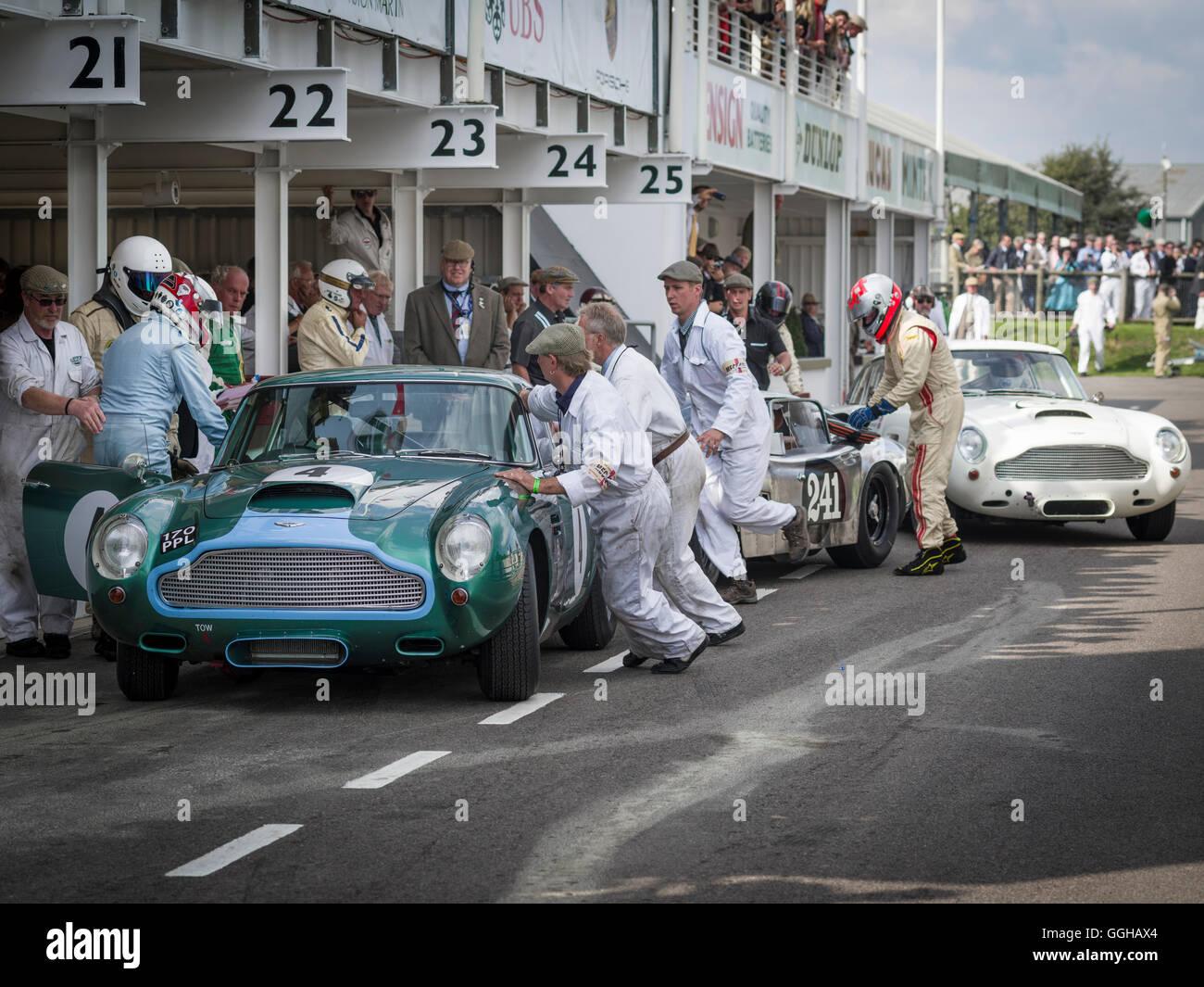 1960 Aston Martin DB4 GT, driver change at the pit lane, RAC TT Celebration, Goodwood Revival 2014, Racing Sport, - Stock Image