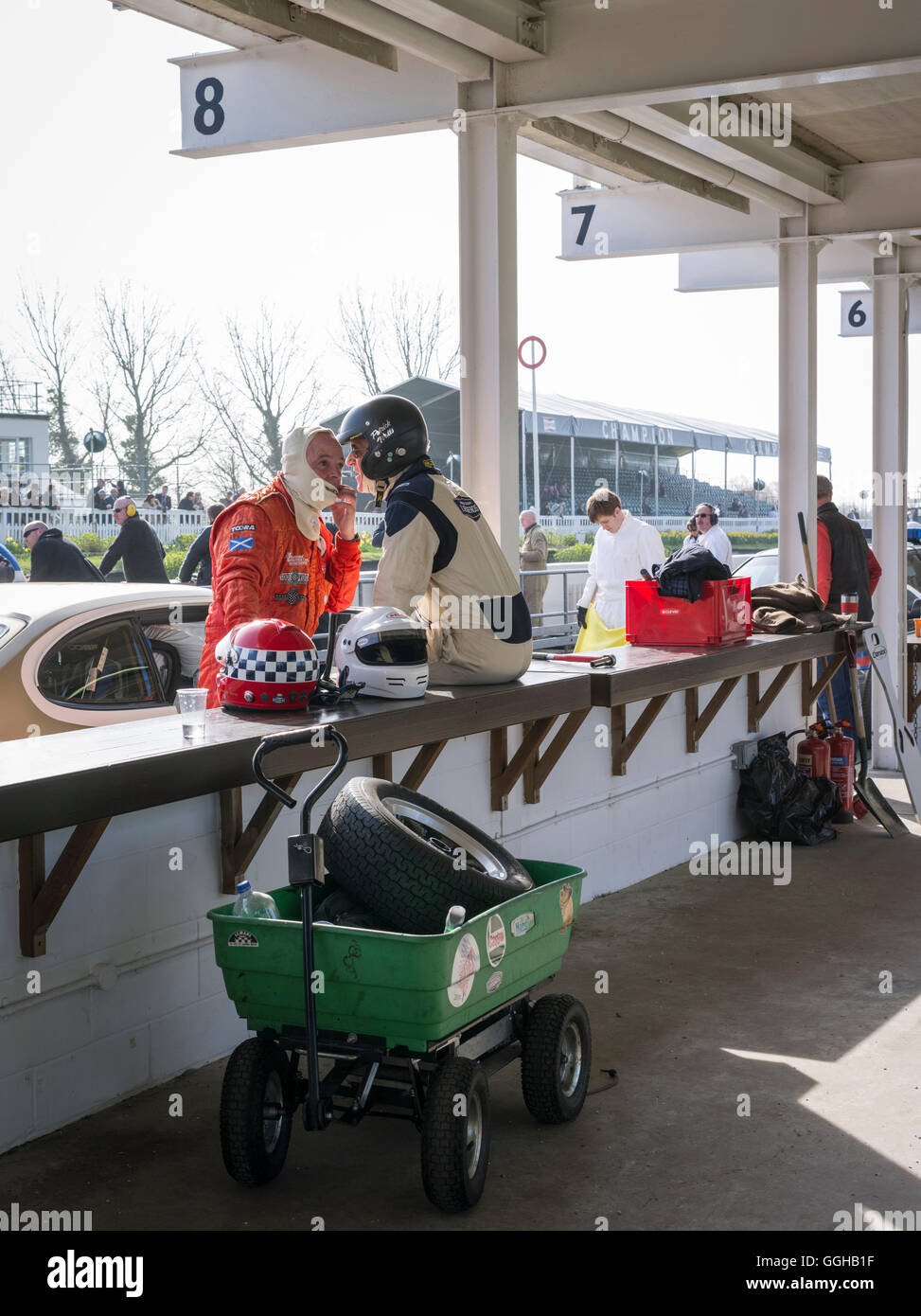 Racing driver in the pit lane, 72nd Members Meeting, racing, car racing, classic car, Chichester, Sussex, United - Stock Image