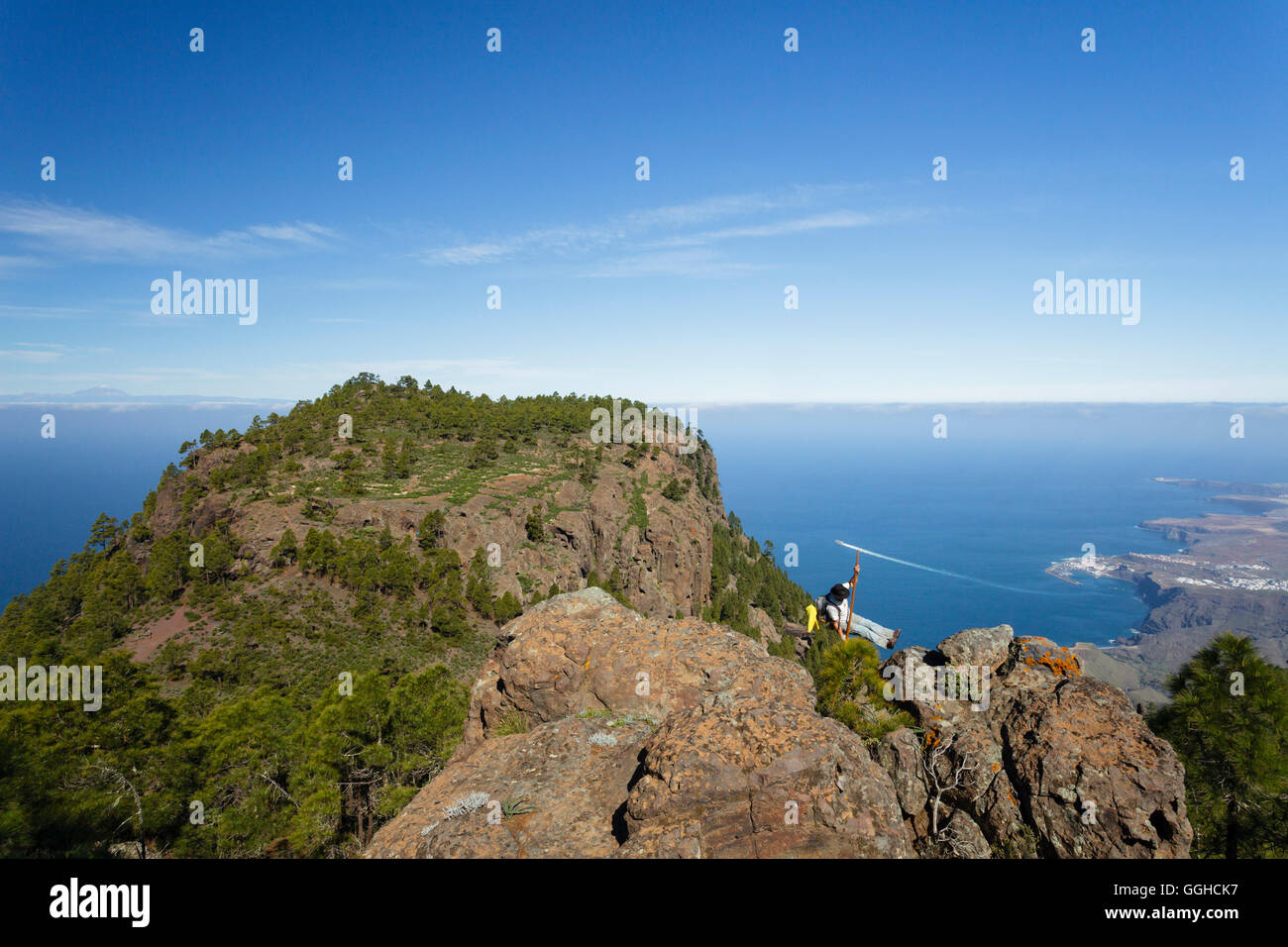 hiker with shepherd´s crook, view from Faneque mountain to Puerto de las Nieves and Agaete, mountains, Natural - Stock Image