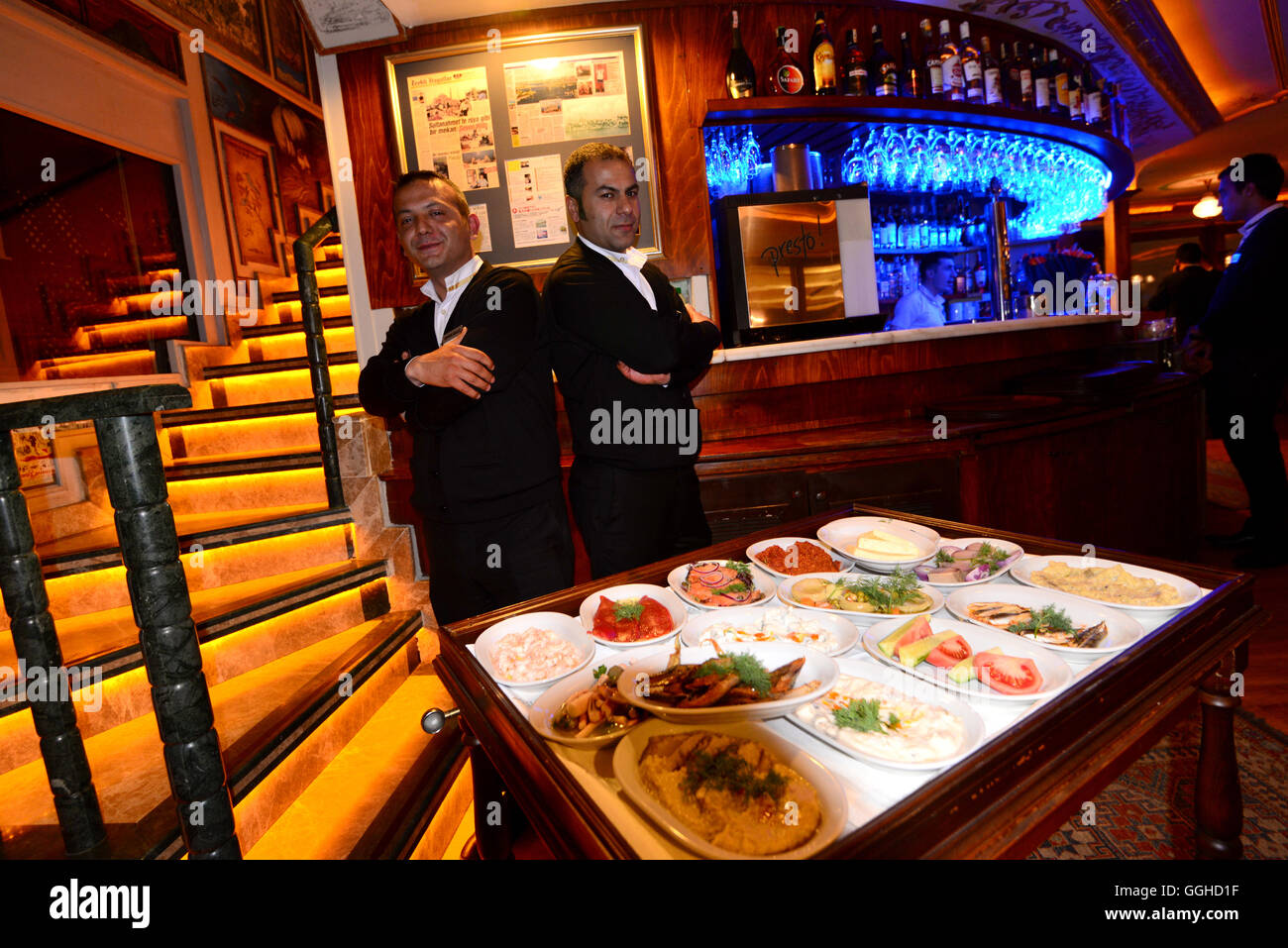 Waiters serving Meze in a hotel restaurant, Sultanahmet, Istanbul, Turkey - Stock Image
