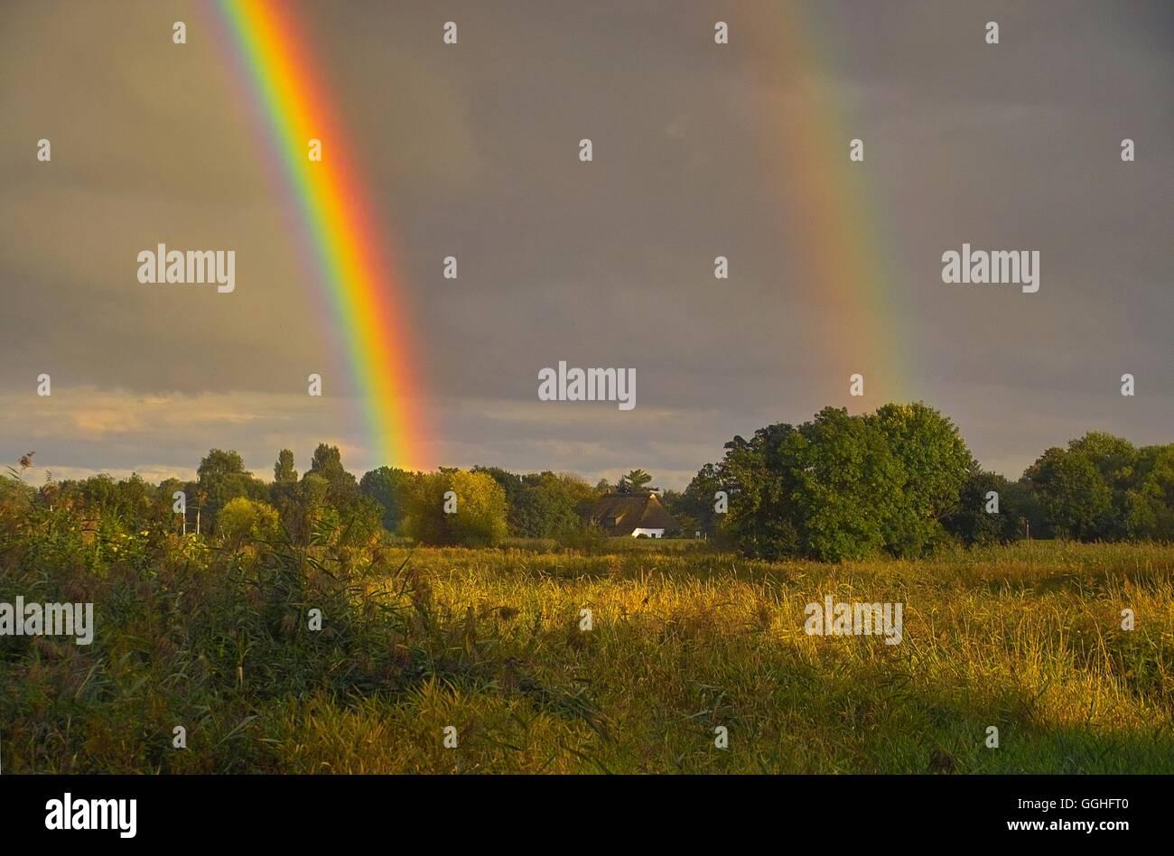 Double rainbow on landscape, pasture / Doppelter Regenbogen über Landschaft in Bremen-St Magnus, - Stock Image