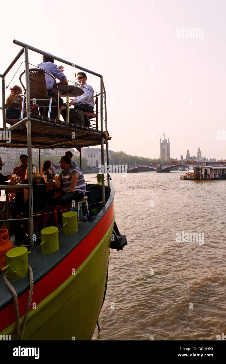 Tamesis Dock Floating Pub at Albert Embankment offers a nice view of the Houses of Parliament aka Westminster Palace, - Stock Image