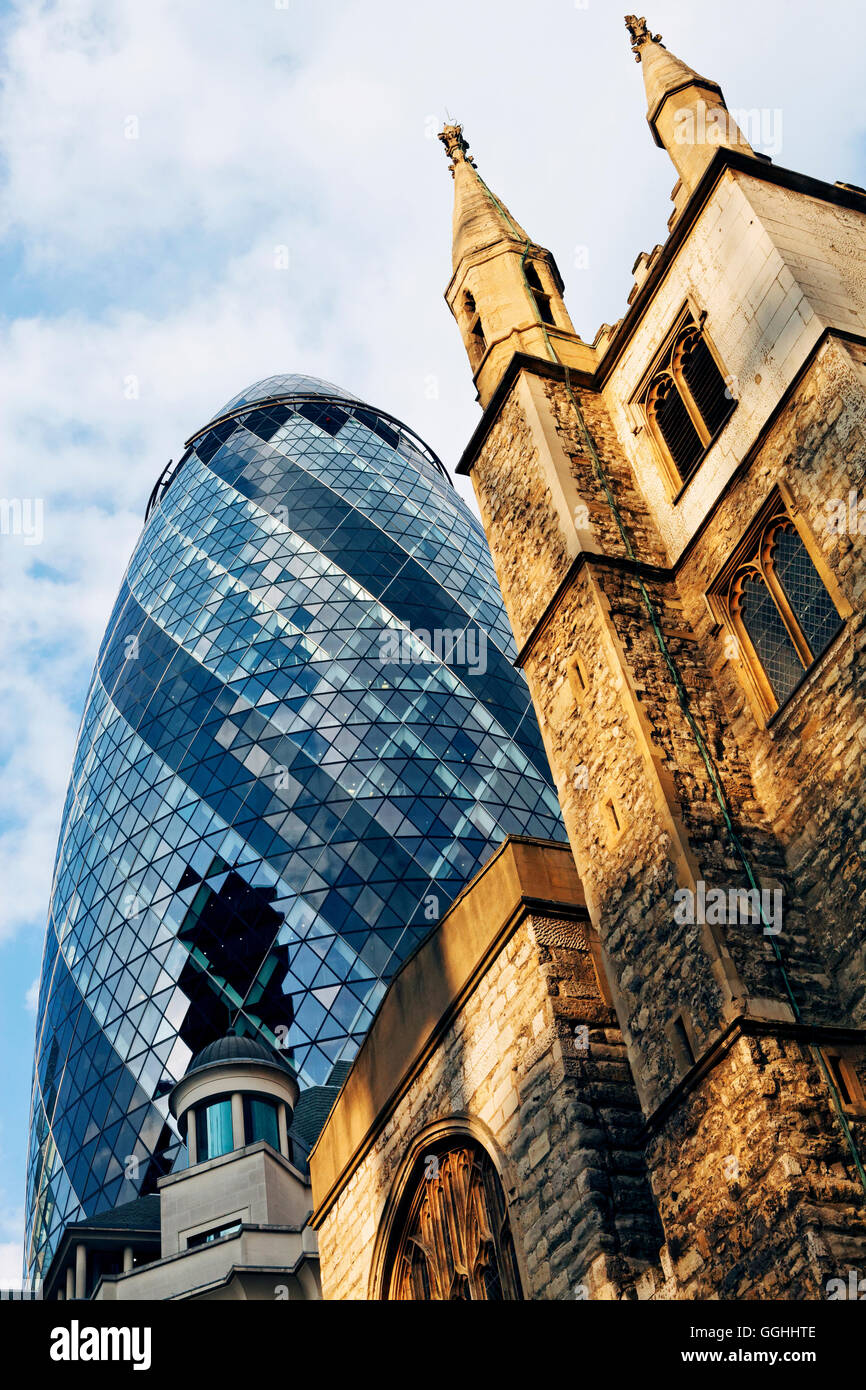 St. Andrew Undershaft and The Gherkin Building, City, London, England, United Kingdom - Stock Image