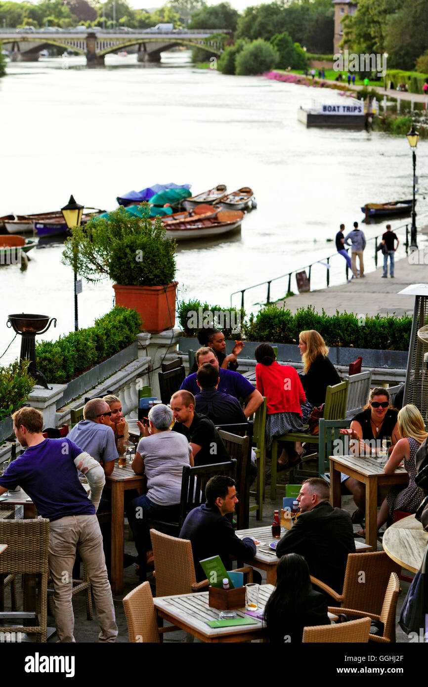 Terrace of the Pitcher and Piano Bar with view over the River Thames, Richmond upon Thames, Surrey, England, United - Stock Image
